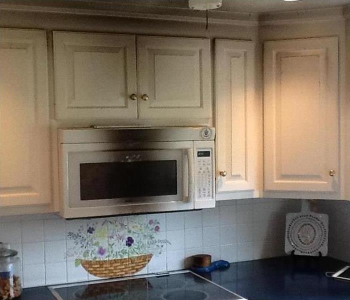 smoke damaged microwave and cabinets