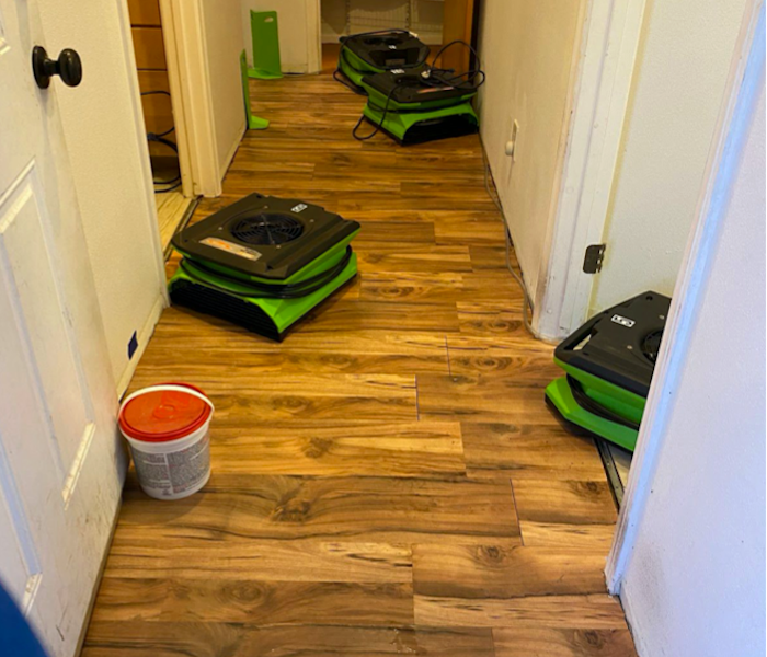 Hardwood floor with SERVPRO drying equipment in the hallway