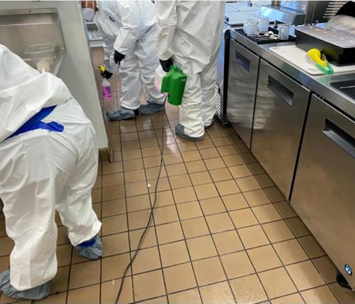 SERVPRO technicians in commercial kitchen with cleaning equipment