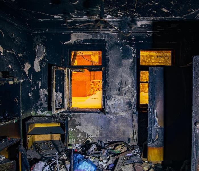 fire damaged room covered in soot